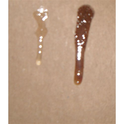 Erotic Massage oil on right (the darker color) and Aphrodisiac Oil on left (lighter color)