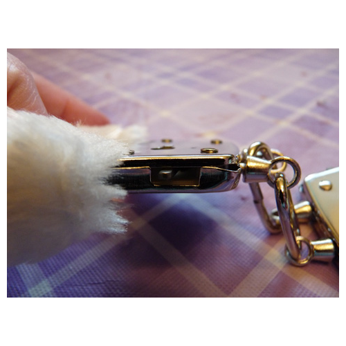 Fuzzy cuffs safety release latch